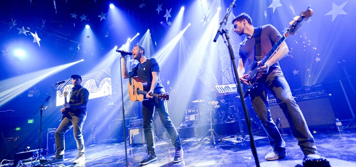 BURBANK, CA - MAY 16:  (L-R) Musicians Jonny Buckland, Chris Martin and Guy Berryman of Coldplay perform onstage during their iHeartRadio Album Release Party at the iHeartRadio Theater Los Angeles on May 16, 2014 in Burbank, California. Streaming Live on Yahoo Screen and Clear Channel stations across the country.  (Photo by Jason Kempin/Getty Images for Clear Channel) *** Local Caption *** Jonny Buckland; Chris Martin; Guy Berryman